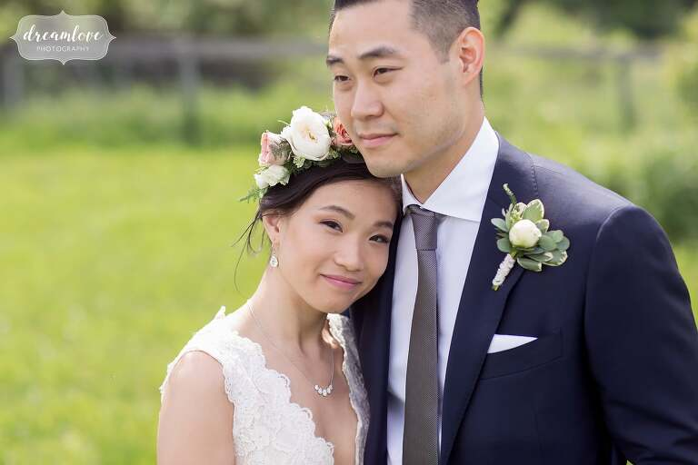 Happy asian bride with flower crown at Hudson Valley wedding.