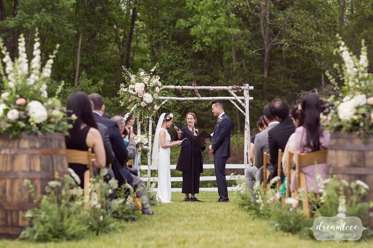 Bride reads vows during Hudson Valley barn wedding.