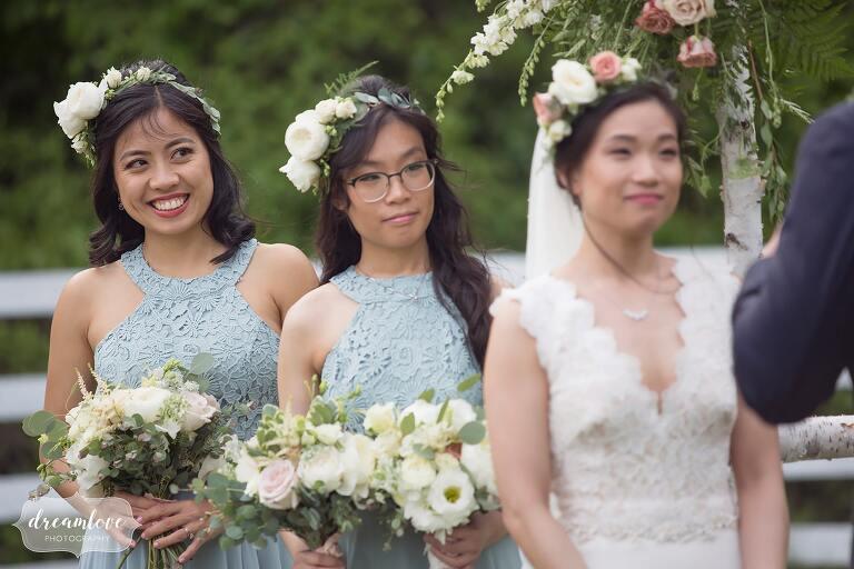 Bridesmaids watch ceremony at Barn at Liberty Farms.