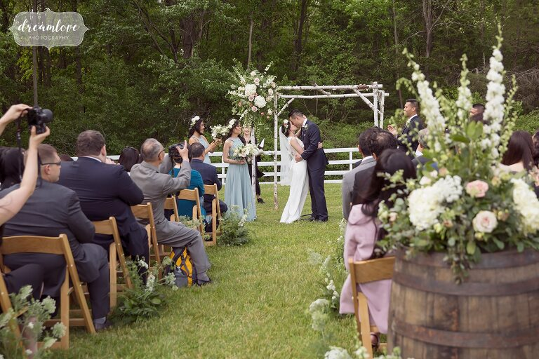 Ceremony kiss at Liberty Farms wedding in Hudson Valley.