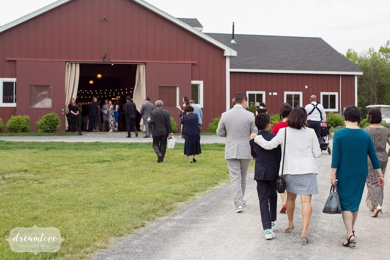 Guests walk into the red barn venue in Hudson Valley.