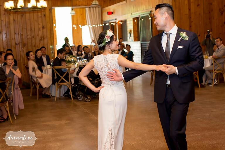 Bride and groom have first dance in horse barn at Liberty Farms.