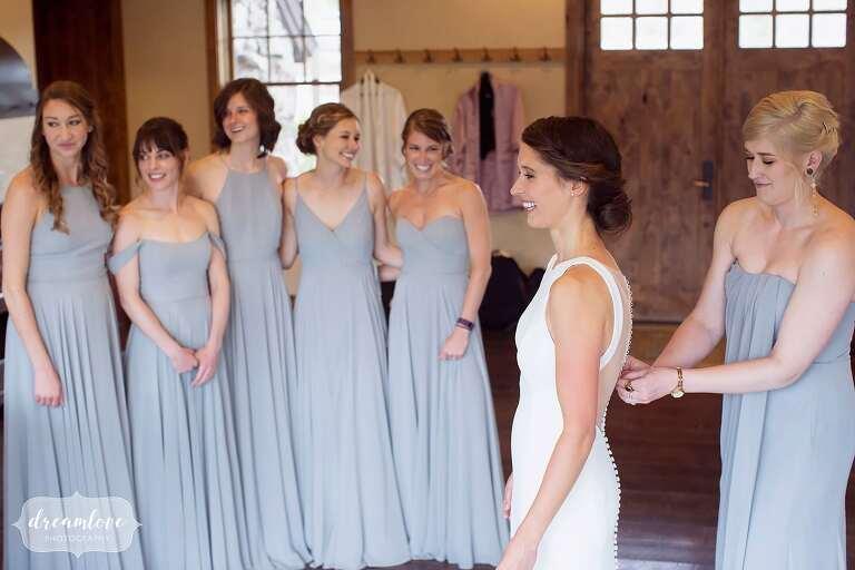 Bridesmaids watch bride in dress at Winter Park wedding.