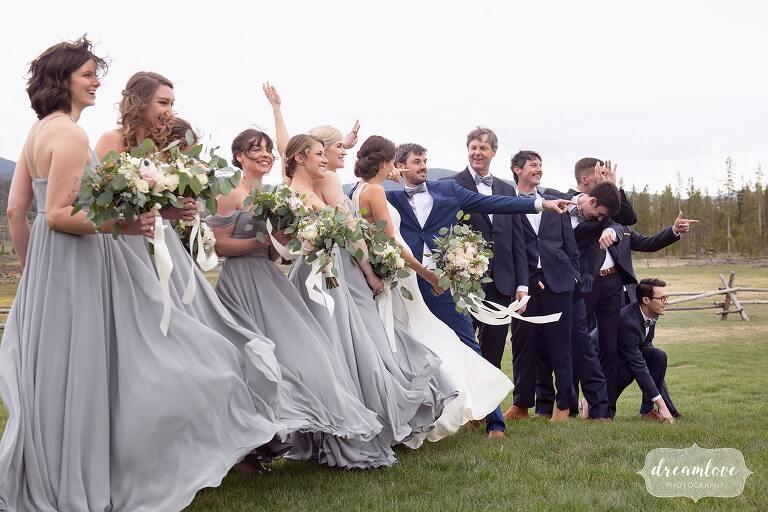 Windy wedding party photos at Colorado luxury mountain wedding.