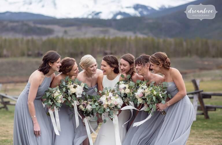 Bride tribe huddled photo in Colorado.