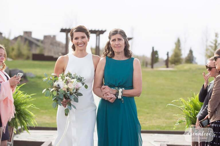 Bride and her mom walk into ceremony at Devil's Thumb.