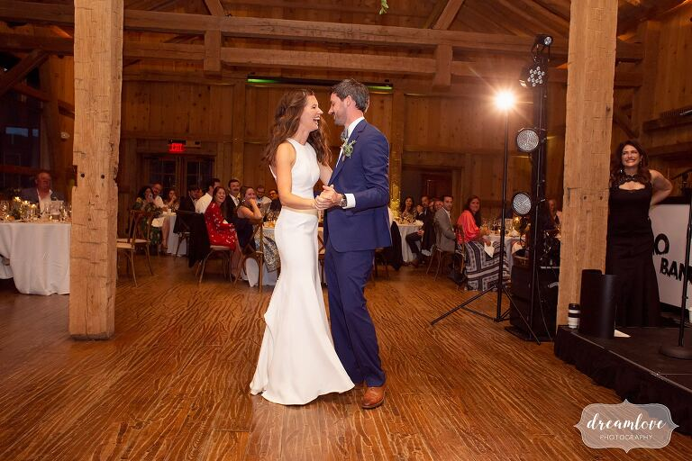 Bride and groom have first dance inside of the lodge at Devil's Thumb.