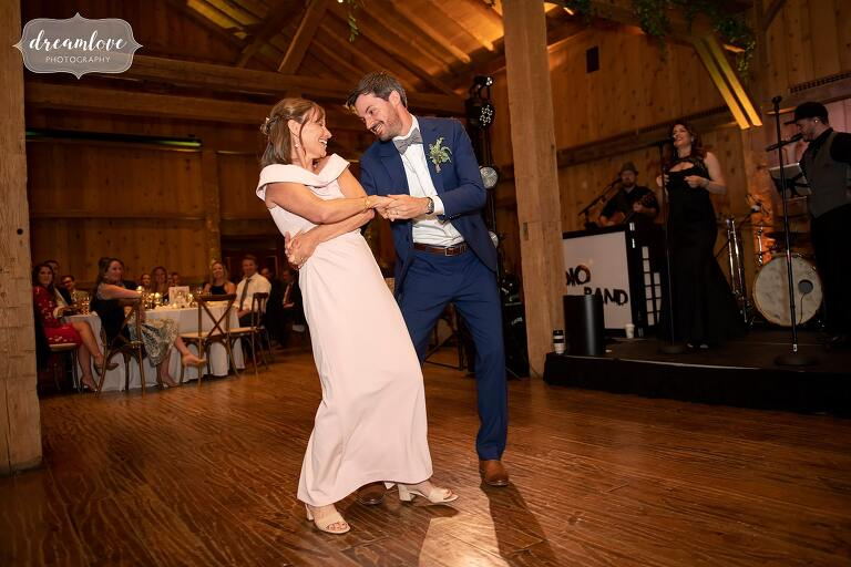 Groom dips his mother during dancing at Devil's Thumb wedding.