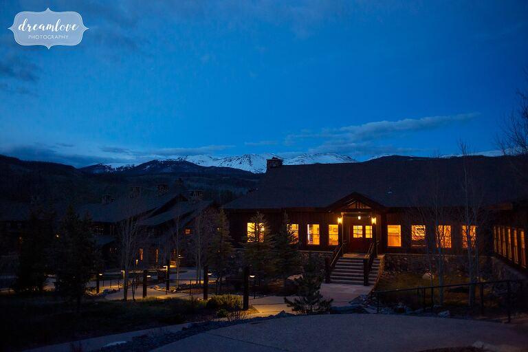 Twilight blue mountains backdrop of Devil's Thumb Lodge wedding venue.