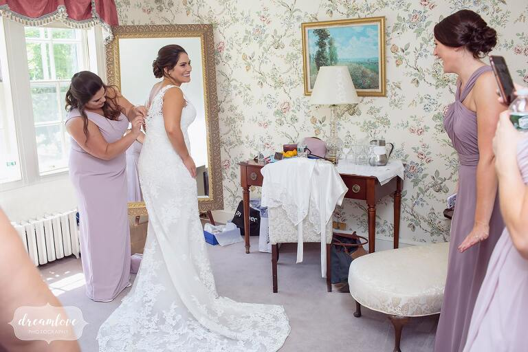 Bride getting ready in bridal suite at Bradley Estate.