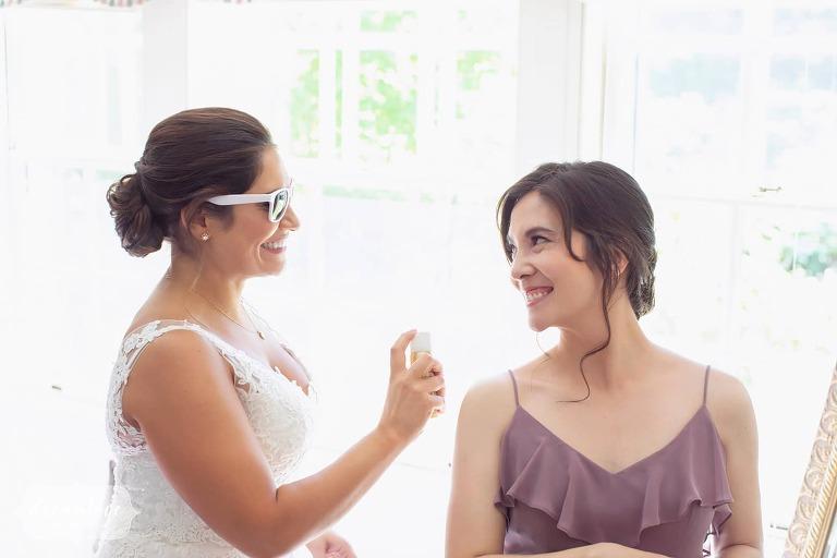 Bride in white sunglasses at Bradley Estate.
