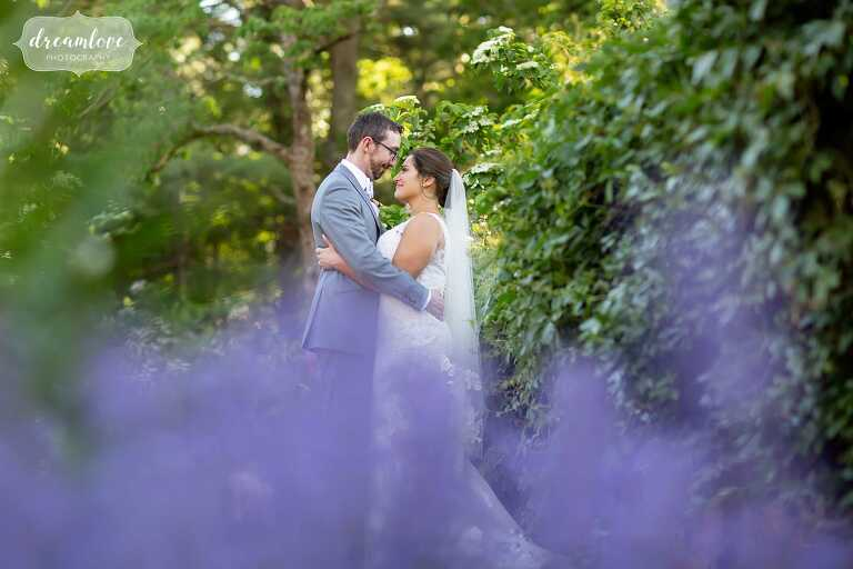 Artistic images of bride and groom through the purple flowers at Bradley Estate.