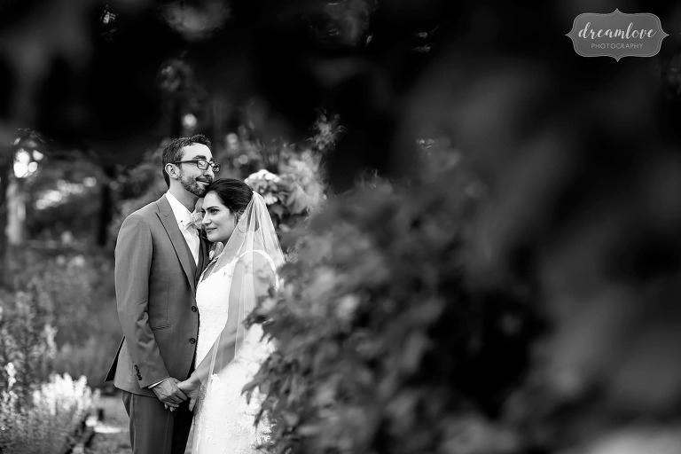Classic wedding photo in black and white of couple in the garden.