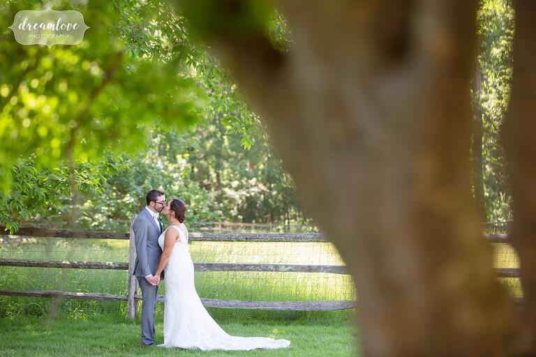 Bride and groom kiss under the trees at Bradley Estate.