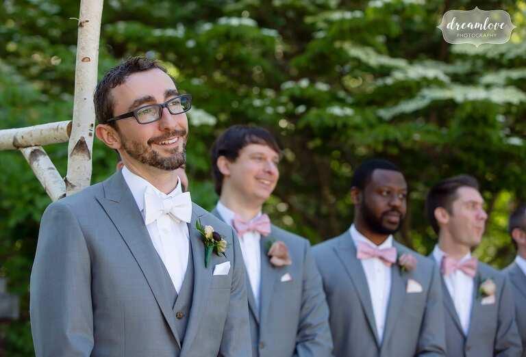 Groom watches bride enter outdoor garden ceremony at Bradley Estate.