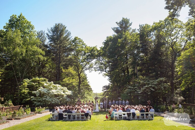 View of summer wedding ceremony outside at Bradley Estate in Canton, MA.