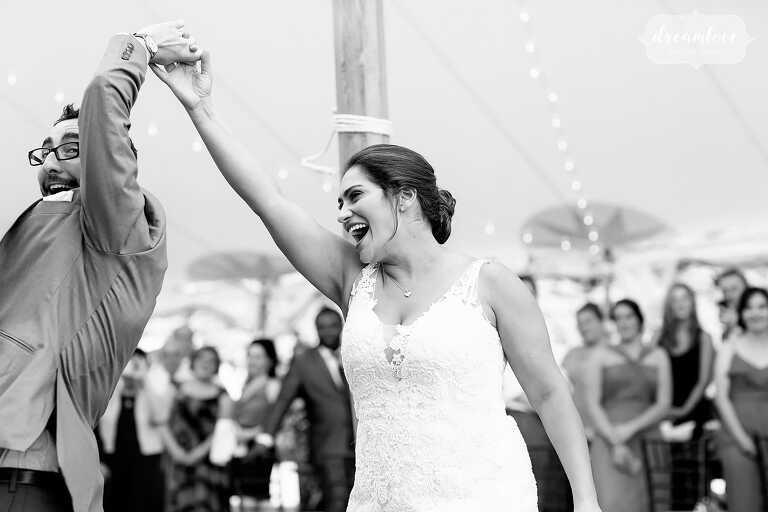Joyful wedding photography bride and groom first dance.