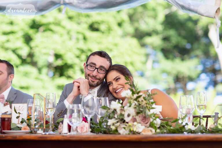 Bride and groom listen to speeches at Bradley Estate.