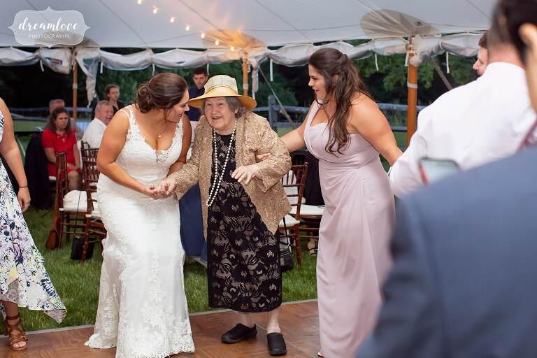 Documentary wedding photo of bride and grandma dancing at Bradley Estate.