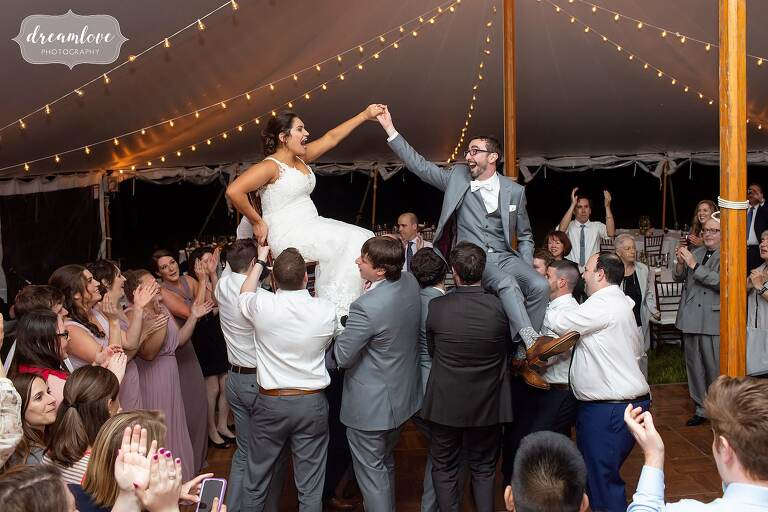 Bride and groom lifted on chairs to do the hora at Bradley Estate.