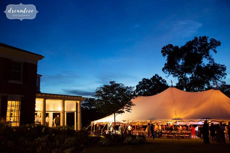 Twilight over the Bradley Estate with golden reception tent.