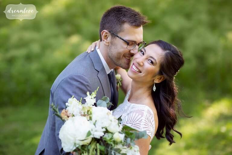 Bride leans back looking at camera at this Boston celestial wedding at Lyman.