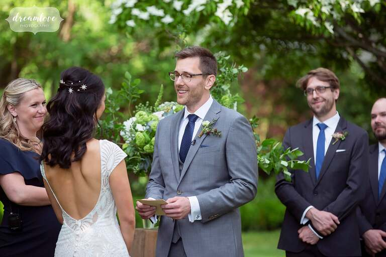 Groom reads vows at Lyman Estate ceremony.