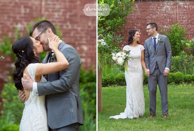 Bride and groom kiss at end of outdoor ceremony in Waltham, MA.