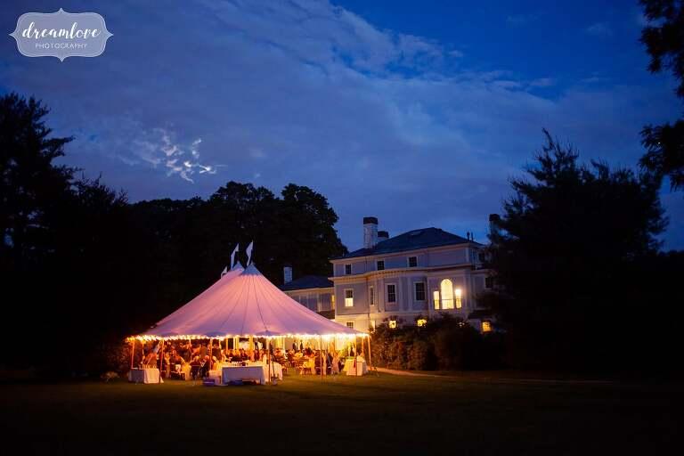 Lyman Estate in blue dusk light with moon.