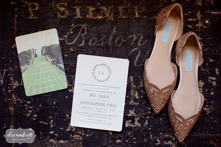 North shore wedding photographers capture invitations and rose gold shoes.