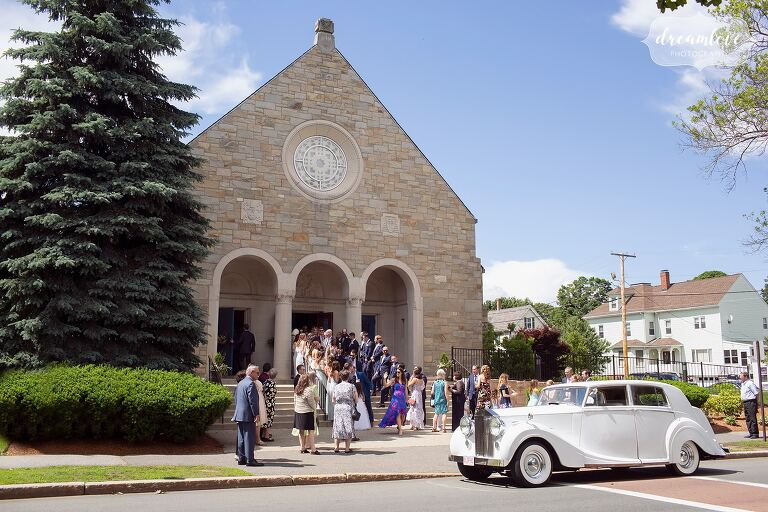 Guests gather in front of St. Mary's Church in Danvers for a wedding.