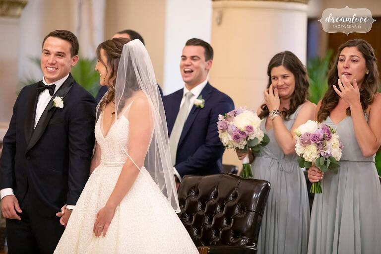 Bride and groom smile at each other at St. Mary's in Danvers, MA.