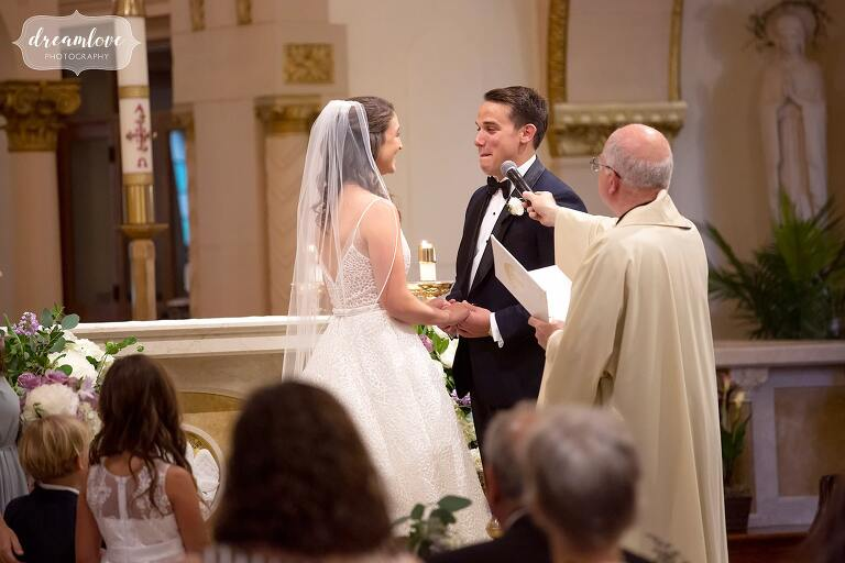 Bride and groom say vows at St. Mary's Church in Danvers, MA.