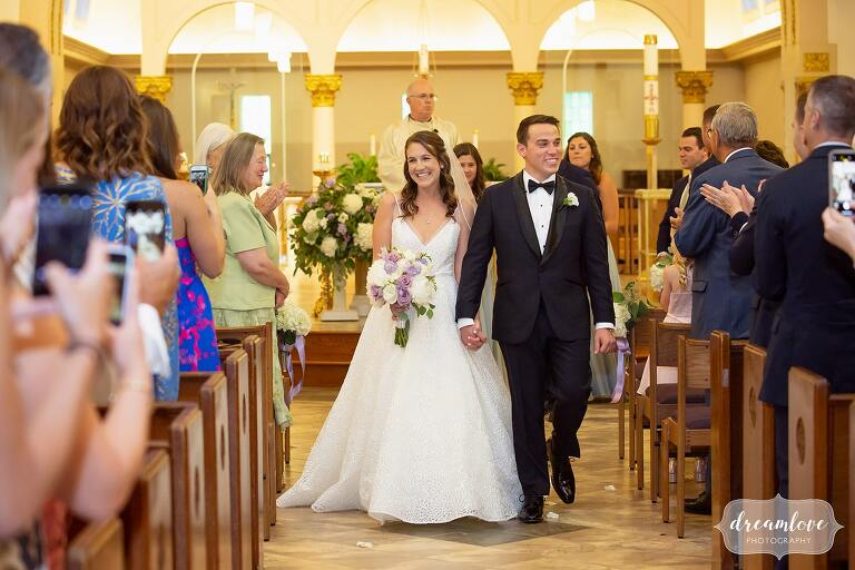 Bride and groom exit ceremony at St. Mary's in Danvers, MA.
