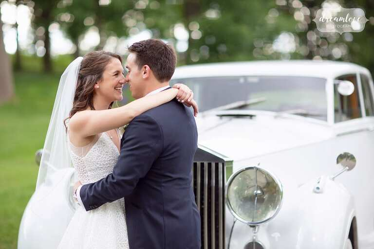 Romantic bride and groom with Rolls Royce at the Crane Estate.
