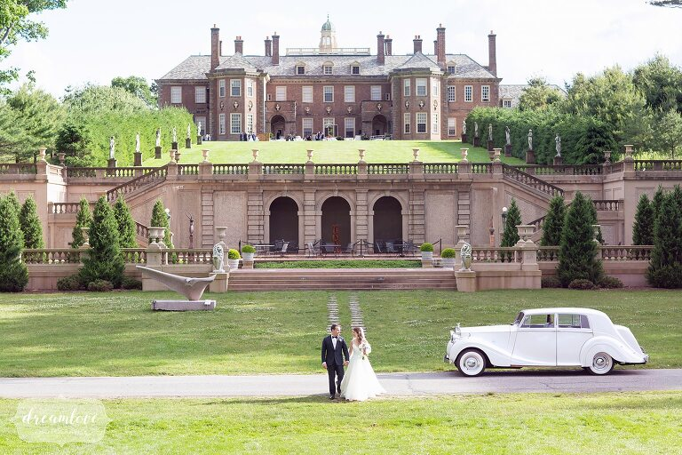 Bride and groom stand in front of Ipswich MA wedding estate venue.