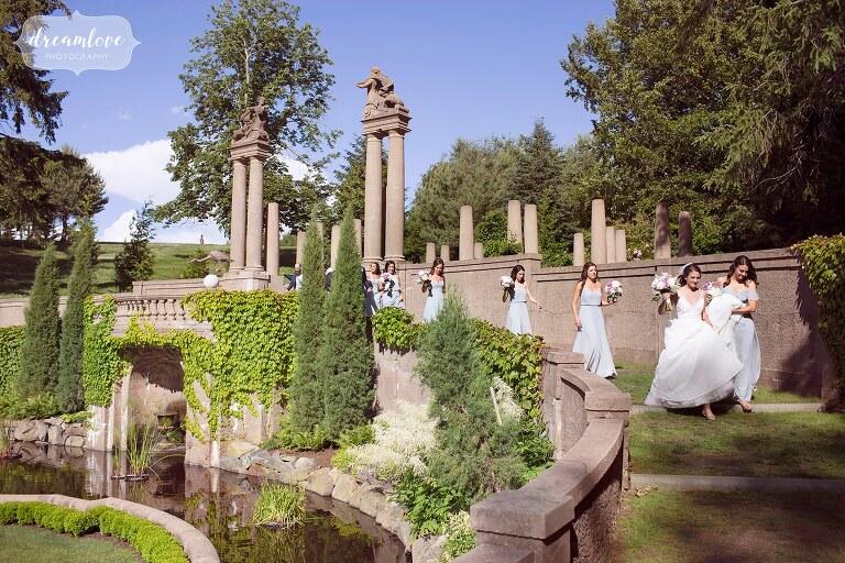 Bride walks into the Italian Garden at the Crane Estate.