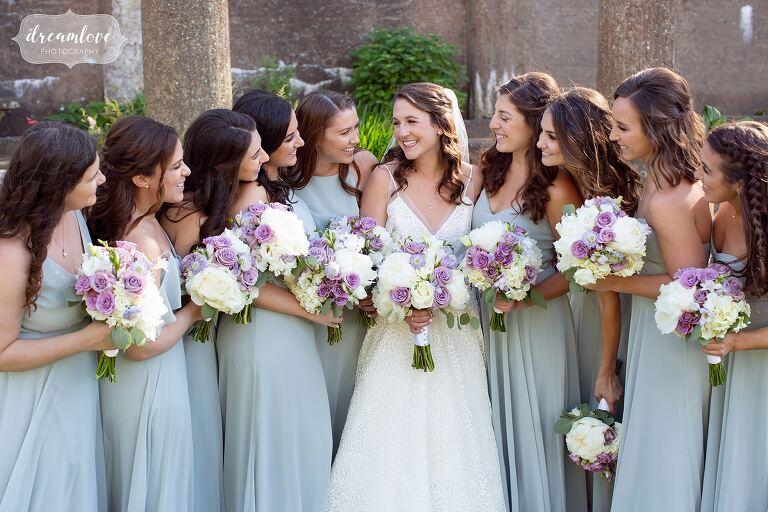 Bride and bridesmaids in the Italian Garden at Crane Estate.