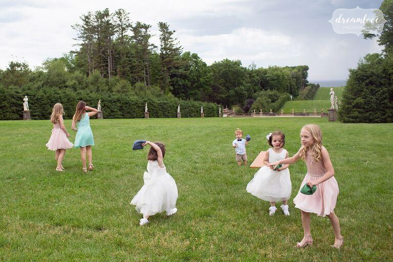 Kids playing on great lawn at Crane Estate wedding.