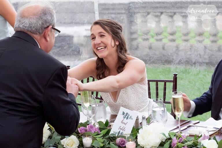 Bride hugs dad after his toast at Crane Estate.