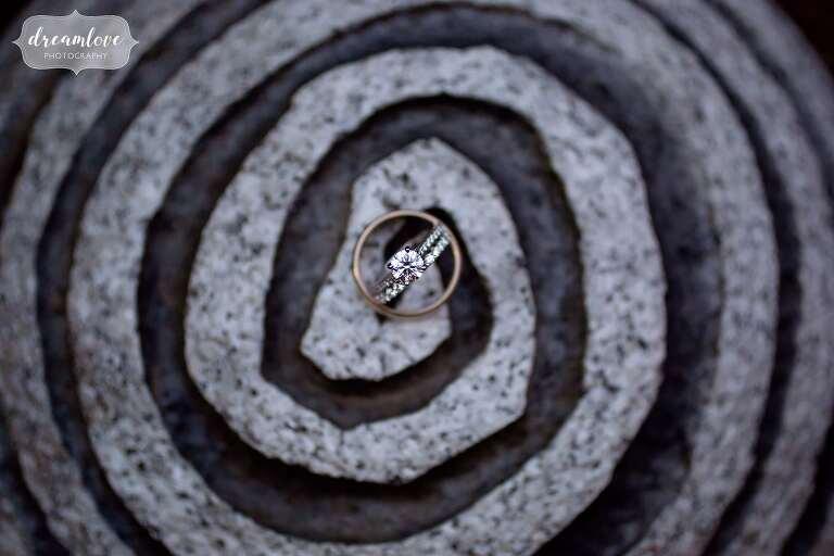 Artistic wedding ring photo on spiral sculpture at Crane Estate.