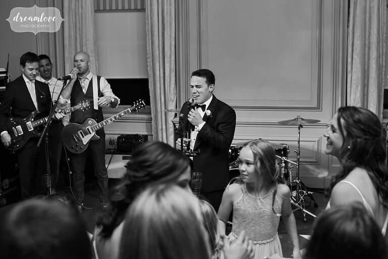 Groom sings the Gambler at his wedding at Crane Estate.
