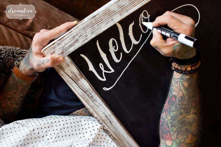 Artistic wedding sign with tattoos.