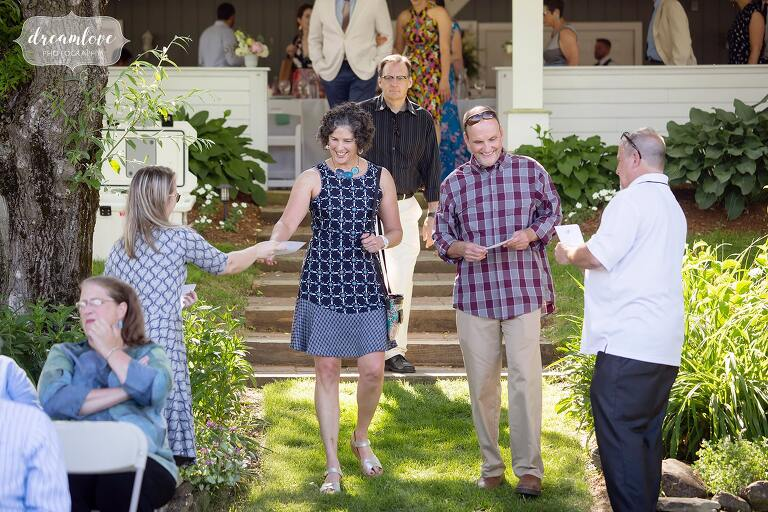 Guests enter outdoor ceremony space at Warfield House Inn.
