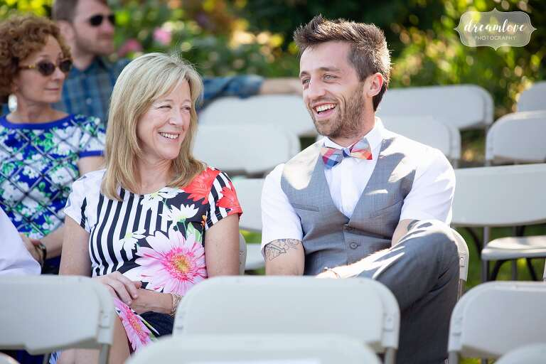 Candid wedding photograph of happy guests at Warfield House Inn.
