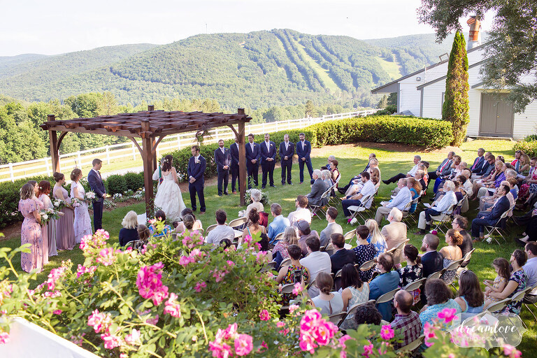 View of the outdoor ceremony location at the Warfield House Inn with Berkshire East ski trails.