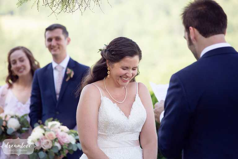 Bride laughs during ceremony vows.