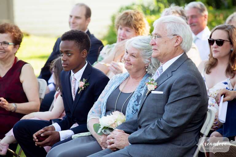Family watches couple get married at Warfield House Inn.