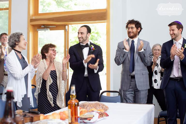 Tish ceremony for groom with clapping and singing.