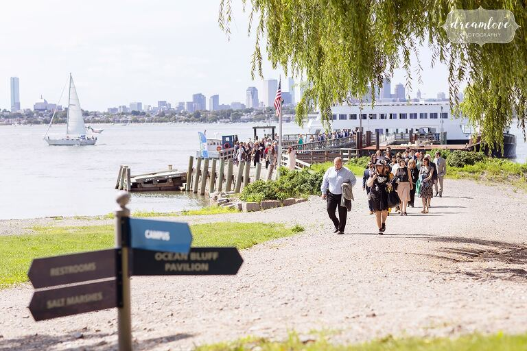 Guests arrive for the Thompson Island Boston wedding overlooking harbor.
